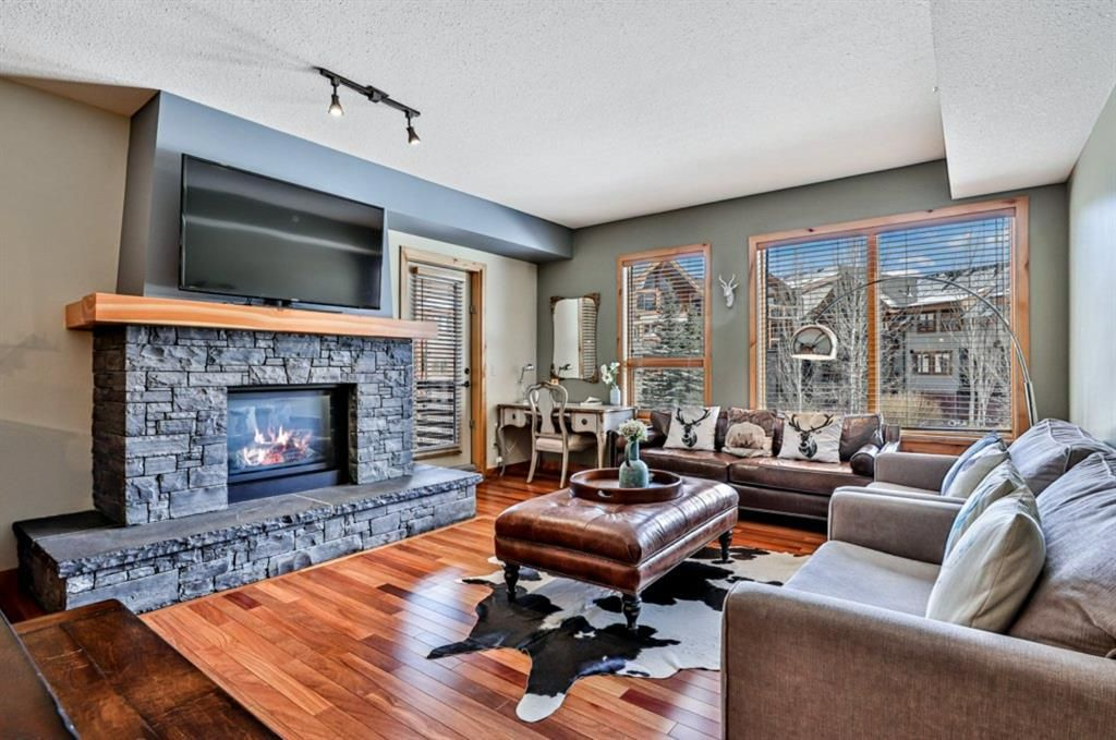 Main Photo: 206 379 Spring Creek Drive: Canmore Apartment for sale : MLS®# A1086899