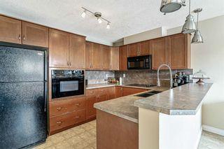 Photo 10: 29 Tucker Circle: Okotoks Row/Townhouse for sale : MLS®# A1097166
