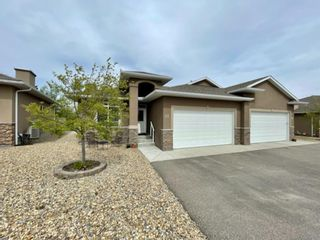 Photo 1: 37 River Heights View: Cochrane Semi Detached for sale : MLS®# A1113108