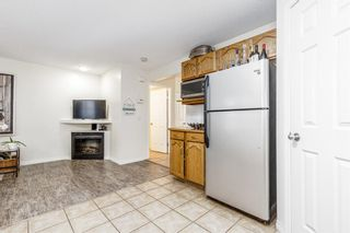 Photo 11: 85 Hidden Creek Rise NW in Calgary: Hidden Valley Row/Townhouse for sale : MLS®# A1104213