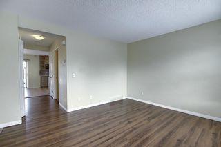 Photo 7: 208 Taradale Drive NE in Calgary: Taradale Detached for sale : MLS®# A1067291