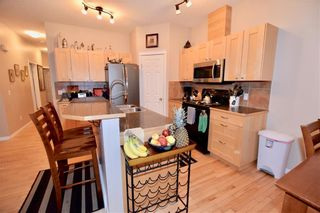 Photo 4: 748 Carriage Lane Drive: Carstairs House for sale : MLS®# C4165695
