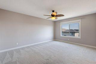 Photo 25: 144 Heritage Boulevard: Cochrane Detached for sale : MLS®# A1125296