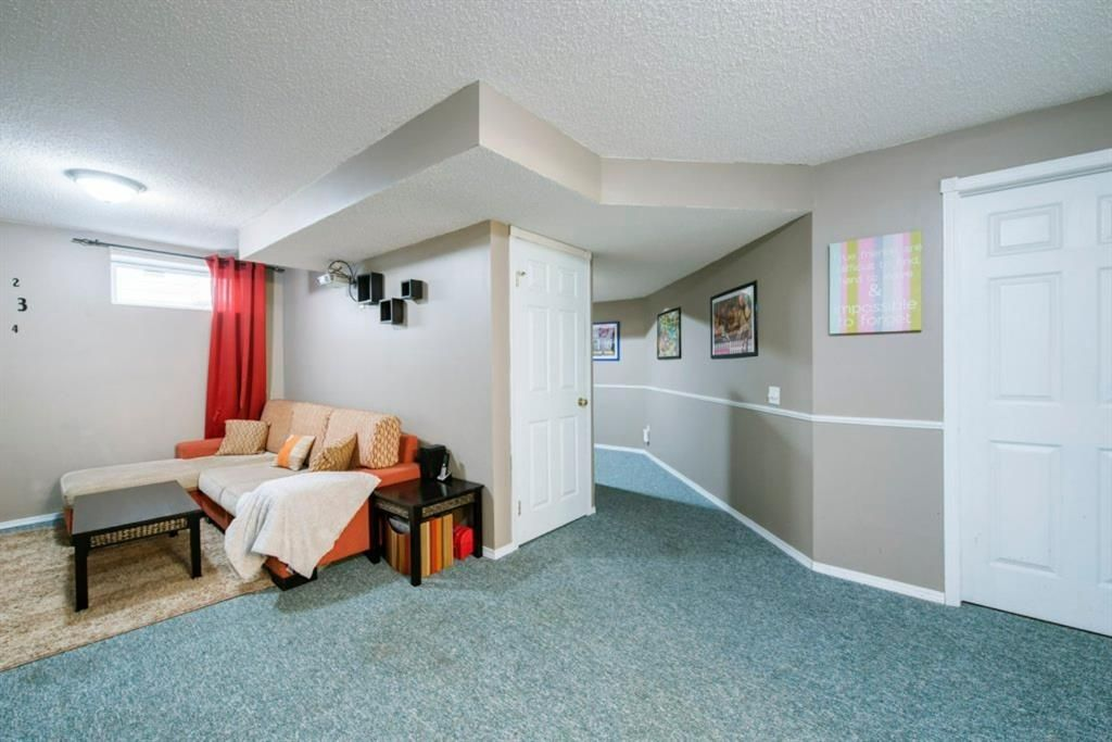 Photo 35: Photos: 10 MT BREWSTER Circle SE in Calgary: McKenzie Lake Detached for sale : MLS®# A1025122
