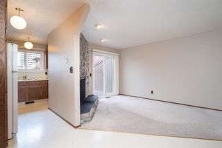 Photo 6: 5 903 67 Avenue SW in Calgary: Kingsland Row/Townhouse for sale : MLS®# A1079413