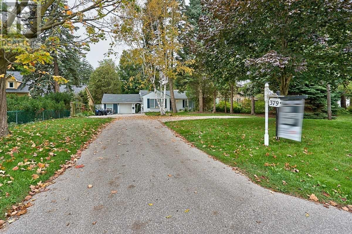 Main Photo: 379 LAKESHORE RD W in Oakville: House for sale : MLS®# W5399645
