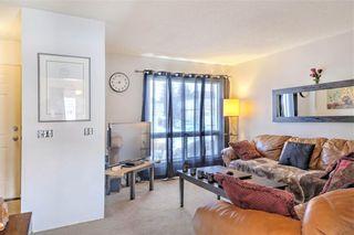 Photo 4: 203 DEERPOINT Lane SE in Calgary: Deer Ridge Row/Townhouse for sale : MLS®# C4288291