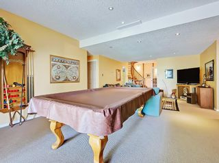 Photo 25: 75 Anatapi Lane SW in Calgary: Springbank Hill Detached for sale : MLS®# A1099057