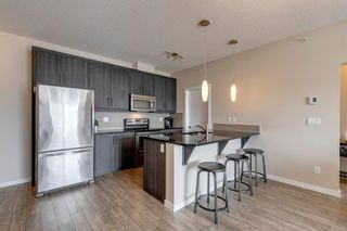 Photo 2: 404 402 Marquis Lane SE in Calgary: Mahogany Apartment for sale : MLS®# A1131322