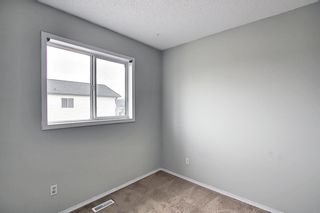 Photo 18: 125 Martin Crossing Way NE in Calgary: Martindale Detached for sale : MLS®# A1117309