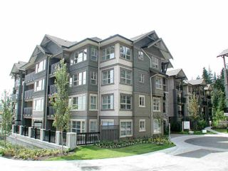 Photo 1: 209 2958 WHISPER WAY in Coquitlam: Westwood Plateau Condo for sale : MLS®# R2618244