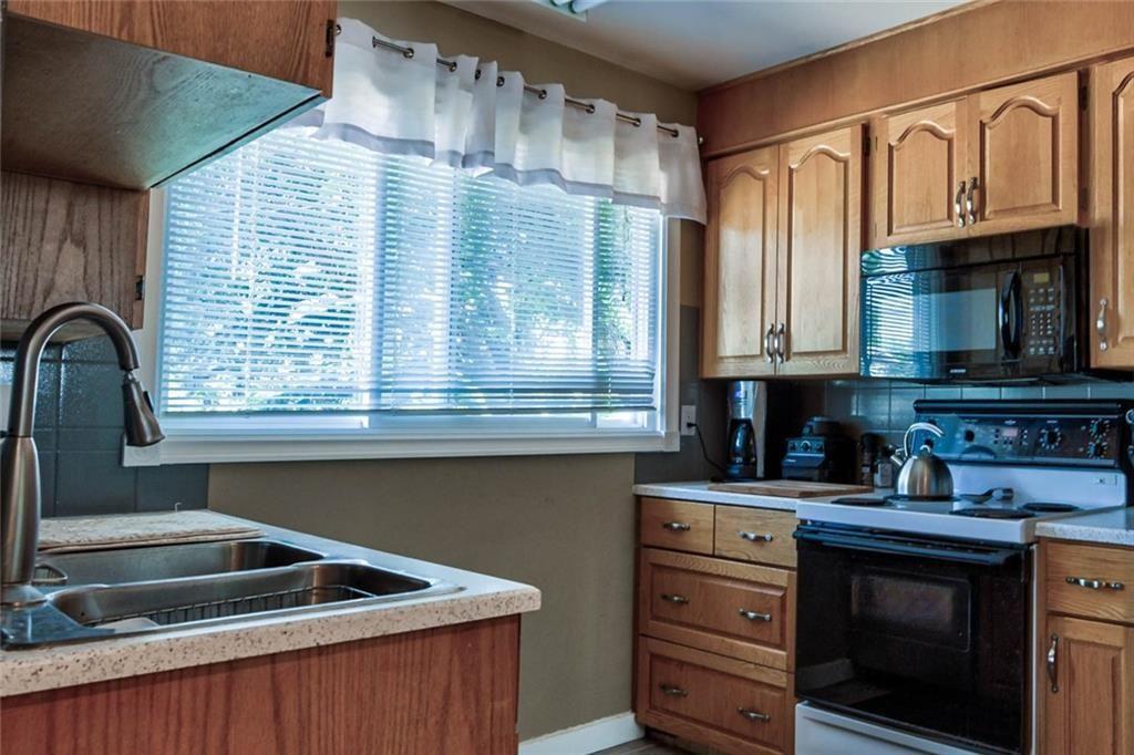 Photo 7: Photos: 624 ARLINGTON Drive SE in Calgary: Acadia Detached for sale : MLS®# C4261601