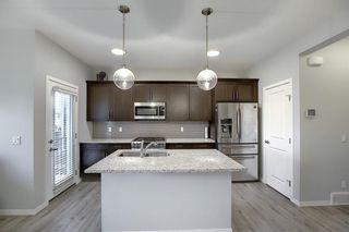 Photo 3: 44 Emberside Place: Cochrane Semi Detached for sale : MLS®# A1036728