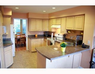 """Photo 2: 38 2990 PANORAMA Drive in Coquitlam: Westwood Plateau Townhouse for sale in """"WESBROOK VILLAGE"""" : MLS®# V768307"""
