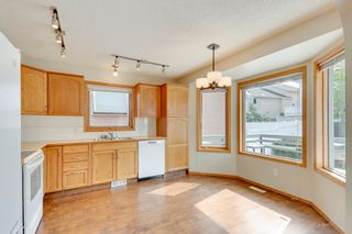 Photo 8: 28 Arbour Ridge Place NW in Calgary: House for sale : MLS®# C4025395