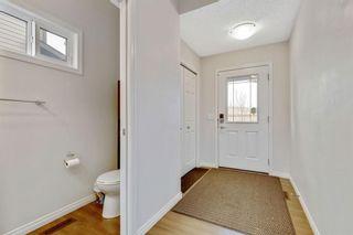 Photo 4: 333 Heartland Crescent: Cochrane Semi Detached for sale : MLS®# A1063240