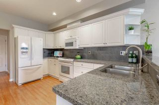 Photo 2: 4 1290 AMAZON DRIVE in Port Coquitlam: Riverwood Townhouse for sale : MLS®# R2315823