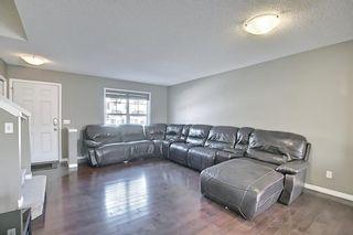Photo 4: 3326 New Brighton Gardens SE in Calgary: New Brighton Row/Townhouse for sale : MLS®# A1077615