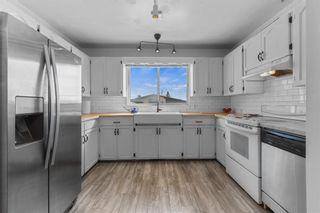 Photo 7: 39 Glacier Drive SW in Calgary: Glamorgan Detached for sale : MLS®# A1123813
