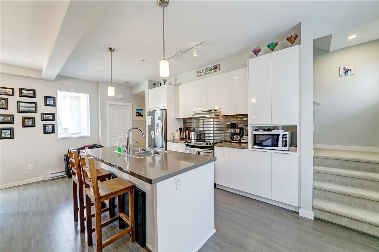 """Main Photo: 82 8138 204 Street in Langley: Willoughby Heights Townhouse for sale in """"Ashbury and Oak by Polygon"""" : MLS®# R2415255"""