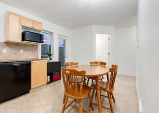 Photo 15: 218 950 ARBOUR LAKE Road NW in Calgary: Arbour Lake Row/Townhouse for sale : MLS®# A1136377