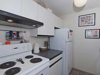 Photo 8: 405 33 ARBOUR GROVE Close NW in CALGARY: Arbour Lake Condo for sale (Calgary)  : MLS®# C3575244