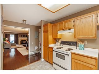 """Photo 9: 103 5641 201 Street in Langley: Langley City Townhouse for sale in """"THE HUNTINGTON"""" : MLS®# R2537246"""