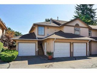 """Photo 1: 233 14861 98TH Avenue in Surrey: Guildford Townhouse for sale in """"THE MANSIONS"""" (North Surrey)  : MLS®# F1429353"""