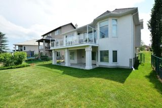 Photo 50: 104 GLENEAGLES Landing: Cochrane House for sale : MLS®# C4127159