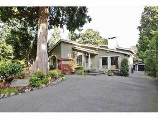 """Photo 1: 12635 26A Avenue in Surrey: Crescent Bch Ocean Pk. House for sale in """"Crescent Heights"""" (South Surrey White Rock)  : MLS®# F1322396"""