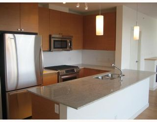 """Photo 2: 704 110 BREW Street in Port_Moody: Port Moody Centre Condo for sale in """"THE ARIA 1"""" (Port Moody)  : MLS®# V743428"""