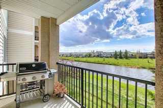 Photo 18: 204 300 Edwards Way NW: Airdrie Apartment for sale : MLS®# A1111430