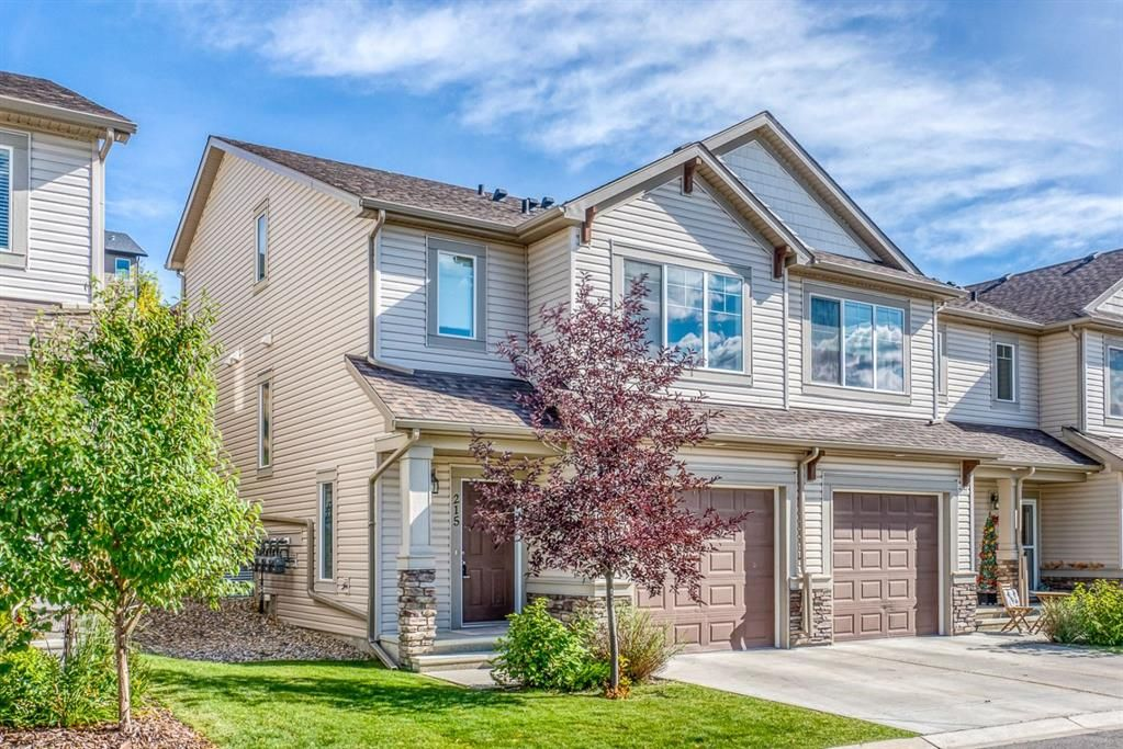 Main Photo: 215 Sunset Point: Cochrane Row/Townhouse for sale : MLS®# A1148057