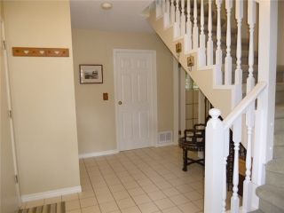 Photo 2: 1424 FOSTER Avenue in Coquitlam: Central Coquitlam House for sale : MLS®# V1008623