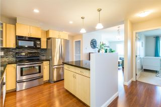 Photo 7: 307 19774 56 Avenue in Langley: Langley City Condo for sale : MLS®# R2437992