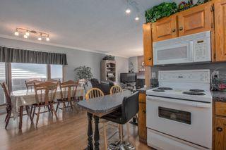 Photo 12: 23 Woodglen Crescent SW in Calgary: Woodbine Detached for sale : MLS®# A1124868