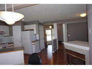 Photo 11: 25 MARTIN CROSSING Green NE in Calgary: Martindale House for sale : MLS®# C4017520