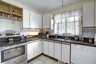 Photo 3: 7011 HUNTERVILLE Road NW in Calgary: Huntington Hills Semi Detached for sale : MLS®# A1035276