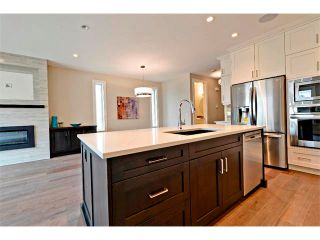 Photo 8: 710 19 Avenue NW in Calgary: Mount Pleasant House for sale : MLS®# C4014701