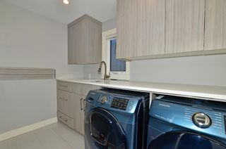 Photo 17: 154 21 Avenue NW in Calgary: Tuxedo Park Row/Townhouse for sale : MLS®# A1098746