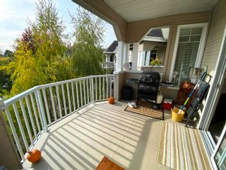 """Photo 30: 313 20897 57 Avenue in Langley: Langley City Condo for sale in """"Arbour Lane"""" : MLS®# R2623448"""