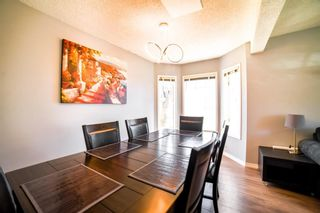 Photo 4: 113 Bedford Manor NE in Calgary: Beddington Heights Row/Townhouse for sale : MLS®# A1095621