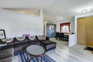 Photo 2: 27 Martinwood Road NE in Calgary: Martindale Detached for sale : MLS®# A1095419