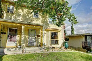 Photo 3: 11137 SACRAMENTO Drive SW in Calgary: Southwood Semi Detached for sale : MLS®# C4270642