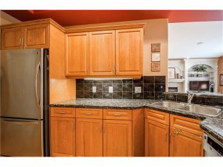 Photo 11: 243 STRATHRIDGE Place SW in Calgary: Strathcona Park House for sale : MLS®# C4101454