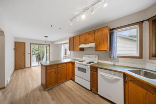 Photo 9: 33 Country Hills Drive NW in Calgary: Country Hills Detached for sale : MLS®# A1140748