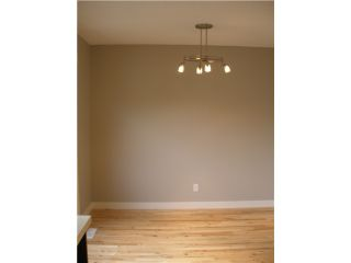 Photo 2: 228 MAUNSELL Close NE in CALGARY: East Mayland Heights Residential Attached for sale (Calgary)  : MLS®# C3445729
