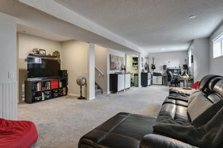 Photo 35: 84 Coach Side Terrace SW in Calgary: Coach Hill Semi Detached for sale : MLS®# A1077504
