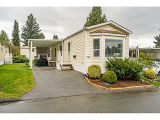 """Photo 1: 186 7790 KING GEORGE Boulevard in Surrey: East Newton Manufactured Home for sale in """"Crispen Bays"""" : MLS®# R2560382"""