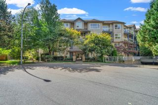 """Photo 1: 409 8115 121A Street in Surrey: Queen Mary Park Surrey Condo for sale in """"The Crossing"""" : MLS®# R2619545"""